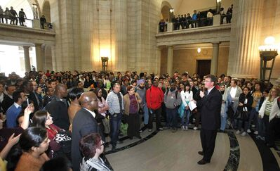 Justice Minister Andrew Swan speaks to members of the immigrant community in April 2012. The question of who invited these people to the rally to protest a decision by Ottawa sparked the original controversy.