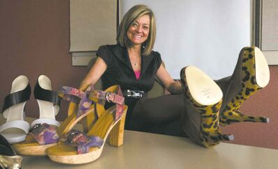 Trish Taylor of the Heart and Stroke Foundation shows off a pair of the shoes that will be auctioned.