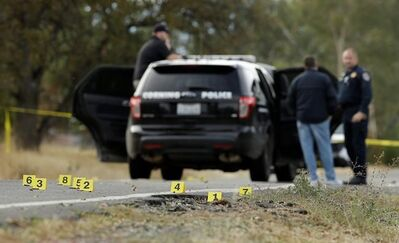 Yellow tags mark where bullet casings found at one of the scenes of a shooting spree at Rancho Tehama Reserve, near Corning, Calif., Tuesday, Nov. 14, 2017. Law enforcement says that five people, including the shooter were killed, and several people including some children were injured during the shooting spree that occurred at multiple locations. (AP Photo/Rich Pedroncelli)