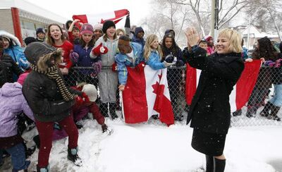 Canada Summer Games Bid Committee Chair Mariette Mulaire  thanks 150 students from École Taché for their performance of 'O Canada.' The committee is touring the city, taking a look at the various sports and special events facilities. The site  for the 2017 Canada Games could fall to Winnipeg.