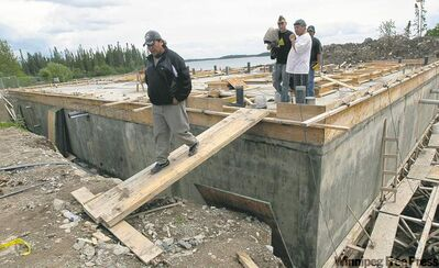 A $6-million water treatment plant is under construction in Red Sucker Lake, but there's no piping to deliver the water to homes and many don't even have storage tanks for truck delivery.