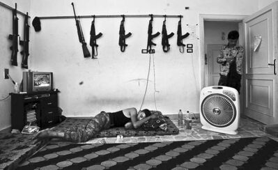 Muhammed Muheisen / The Associated PressA Syrian rebel sleeps after returning from fighting Syrian army forces in Aleppo Sunday.