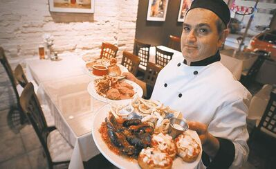 Michele Di. Fonte, owner of Monticchio Ristorante Italiano with Appetizer Platter, Chicken Portafoglio, and Stromboli.