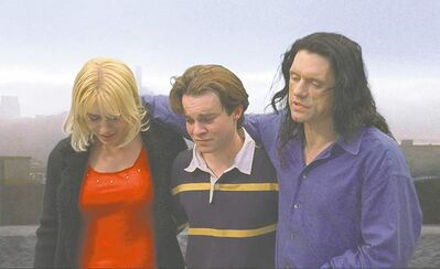 Chloe Productions / TPW Films / The Associated PressIn this film publicity image released by Chloe Productions/TPW Films, Juliette Danielle, left, Philip Haldiman, centre, and Tommy Wiseau are shown in a scene from The Room.