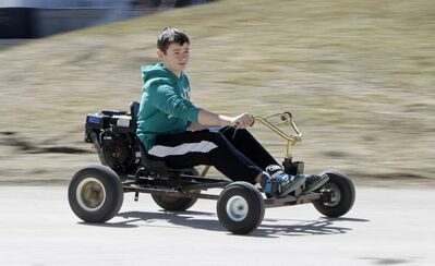 Jackson Pankratz, 12, rides his award-winning go-cart Sunday.
