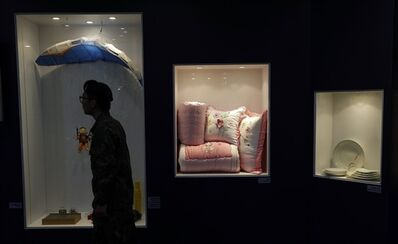 A South Korean soldier walks by products made at Kaesong industrial complex in North Korea displayed at a showroom at the unification observation post near the border village of Panmunjom, that has separated the two Koreas since the Korean War, in Paju, north of Seoul, South Korea, Thursday, April 18, 2013. The South Korean entrepreneurs who invested up to 10 years and millions of dollars in the Kaesong industrial complex, a symbol of economic collaboration between the rival Koreas that is now shuttered by the North, have little more than hope to cling to as assembly lines sit idle day after day. (AP Photo/Lee Jin-man)
