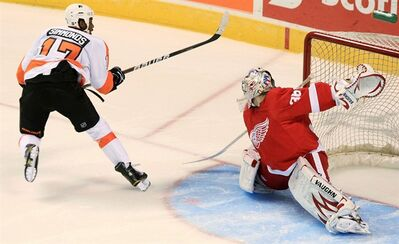 Philadelphia Flyers' Wayne Simmonds scores on Detroit Red Wings goalie Jordan Pearce during the shoot out of pre-season NHL hockey action in London, Ontario, Thursday, September 22, 2011. A man who threw a banana at Simmonds during an NHL exhibition game in London, Ont., has been fined $200.Christopher Moorhouse's lawyer entered a guilty plea today on behalf of his 26-year-old client, who did not appear in court. THE CANADIAN PRESS/Dave Chidley