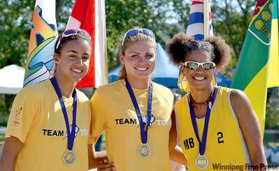 An exhausting Summer Games tournament was well worth it for Manitoba volleyball gold medallists Ozana Nikolic (left), Shanlee McLennan (centre) and coach Wanda Guenette.