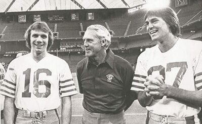 Pontiac, Michigan - (LtoR) San Francosco Forty Niners Quarterback Joe Montana, Coach Bill Walsh, and Receiver Dwight Clark in the Pontiac Silverdome. Niners vs Bengals in Superbowl XVI. January 20, 1982. (AP Laserphoto)