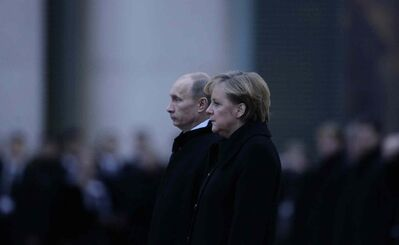 German Chancellor Angela Merkel, right, and Russian President Vladimir Putin.