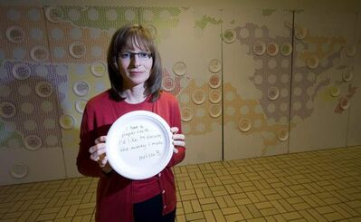 Katharine Schmidt, posing with a food bank art project in 2010, had hoped food bank use in Canada was levelling off, but it rose during the past year.
