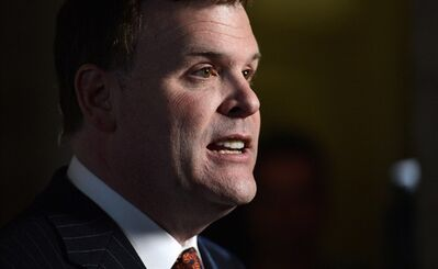 Minister of Foreign Affairs John Baird takes part in a press conference in the foyer of the House of Commons on Parliament Hill in Ottawa on Tuesday, Feb 5, 2013.THE CANADIAN PRESS/Sean Kilpatrick