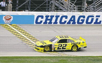 Joey Logano crosses the finish line to win the NASCAR Nationwide Series STP 300 auto race at Chicagoland Speedway in Joliet, Ill., Sunday, July 21, 2013. (AP Photo/Nam Y. Huh)