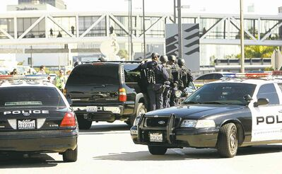 Al Seib / MCTLos Angeles police deploy outside of Terminal 3 at Los Angeles International Airport on Friday.
