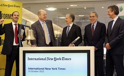 New York Times company chief executive officer Mark Thompson, second from left, rings the bell at the opening of Euronex quotations, in Paris, Tuesday Oct. 15, 2013. The New York Times Co. has rebranded its Paris-based daily, the International Herald Tribune, as the International New York Times — a bid to lure readers abroad amid the upheaval of the digital era facing traditional newspapers. Other people in photo, from left, NYSE Euronext deputy director of the International Listings Department Nathanael Mauclair, Arthur Ochs Sulzberger Jr. chairman of the board of the New York Times Company, Michael Golden vice chairman of the Nerw York Times Company , and President of the International New York Times Stephen Dunbar-Johnson. (AP Photo/Remy de la Mauviniere)