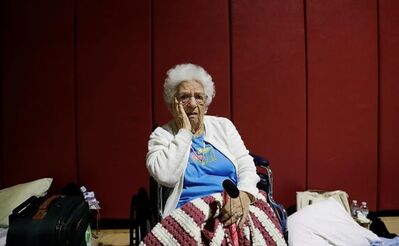 "Mary Della Ratta, 94, sits in shelter after evacuating her home with the help of police last night ahead of Hurricane Irma in Naples, Fla., Sunday, Sept. 10, 2017. ""I'm afraid of what's going to happen. I don't know what I'll find when I go home,"" said Della Ratta whose husband passed away ten years ago. ""I have nobody. I'm all alone in this world."" (AP Photo/David Goldman)"