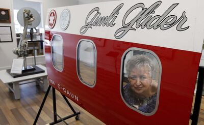Barb Gluck, president of the The Gimli Glider Exhibit, with a part of the fuselage on display from the Boeing 767 that landed in Gimli on July 23, 1983.</p></p>