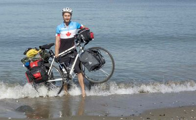 Graeme Loader, 24, was struck by an SUV on Highway 1A near Brandon on Monday. The Toronto cyclist was riding across the country raising money for the World Wildlife Foundation's conservation efforts.