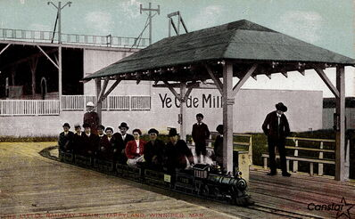 All aboard! Early 20th century Winnipeggers ride The Little Railway Train at Happyland amusement park, which was located in Wolseley over 100 years ago.