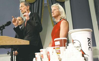Richard Drew / The Associated Press archivesNew York City officials announce plans at the end of May to ban large sugary drinks from eateries.