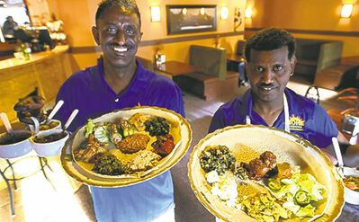 Elias Kebede, left, and chef Demisse Gitahun