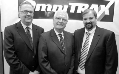 BORIS MINKEVICH / WINNIPEG FREE PRESS archivesOmniTrax executives Kevin Shuba (left) and Darcy Brede (right) welcome Merv Tweed  as their new president of OmniTrax Canada in August.