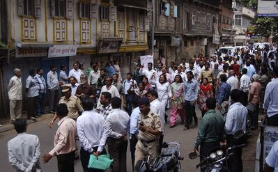 FILE - In this Aug. 20, 2013 file photo, people shout slogans as they protest the killing of anti-superstition activist Narendra Dabholkar in Pune, India. Lawmakers have passed a bill aimed at debunking black magic and prosecuting religious charlatans in a western Indian state after the murder of rationalist activist Dabholkar who campaigned nearly two decades for the legislation. (AP Photo/Nitin Lawate, File)
