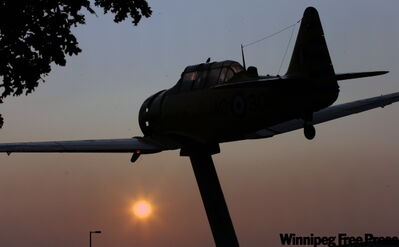 It was a good Start to a great week, as the bright orange sun rose over Winnipeg this morning. Pictured is a Harvard MK4 trainer at Air Force Way Garden of Memories park which commemorates the Winnipeg-based Commonwealth Air Training Plan aircraft and pilots of the Second World War.