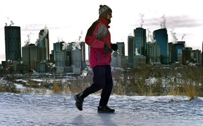 A jogger runs past the steaming Calgary skyline on Jan. 19, 2012. 'Tis the season for resolutions. The Canadian Press asked a number of doctors, health organizations and public health experts to name the one health-related resolution they wish people would make for 2013. Get some exercise, tops the list. THE CANADIAN PRESS/Jeff McIntosh