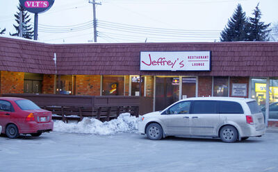 Police have taped off a large area  outside Jeffrey's Restaurant and Lounge on Henderson Highway.