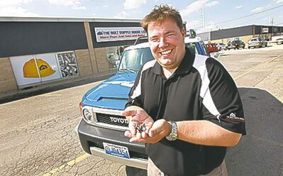 Dean Hart  branch manager of the Bolt Supply House, sells 'security screws' for Jets and Bombers licence plates.