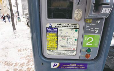 KEN GIGLIOTTI / WINNIPEG FREE PRESSA sticker on one of the modified meters on high-use downtown streets advises parkers they must now pay $2 an hour. Stdup ���v����v?���v� The long process of changing the meter parking kiosks  to the new lighter coinage , ealier and later  paid times and $2 per hour charge has begun on Main St. In the Exchange District , the process takes about one hour to complete . Jen Skerritt  story  KEN GIGLIOTTI  / WINNIPEG FREE PRESS  /  Nov 13 2012