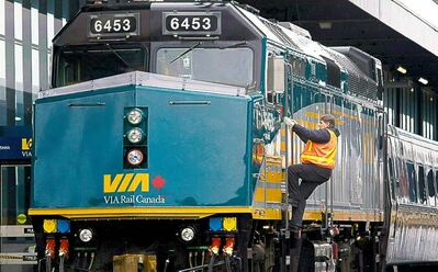 An accused terrorist has been linked to two Canadians charged in a Via Rail plot.