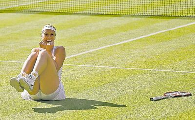 Sabine Lisicki rejoices after defeating Agnieszka Radwanska in their singles semifinal match Thursday.