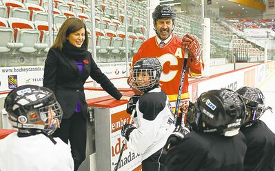 jeff mcintosh / the canadian pressMinister of Health Rona Ambrose and former Calgary Flames player Jamie Macoun meet with minor hockey players in Calgary.