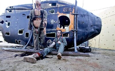 In this Tuesday Feb. 12, 2013, photo, former Navy corpsman Joel Booth, who lost a leg in Afghanistan, plays his role as a downed helicopter pilot in a military training exercise at San Diego-based Strategic Operation (APPhoto/Lenny Ignelzi)