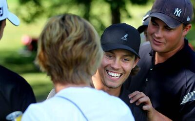 Josh Wytinck accepts congratulations after winning the 2012 Nott Autocorp Manitoba Men's Amateur championship in a playoff.