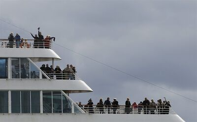 Passengers wave as the MS Balmoral sets sail for the Titanic memorial cruise from Southampton, England, Sunday, April 8, 2012. Nearly 100 years after the Titanic went down, a cruise with the same number of passengers aboard is setting sail to retrace the ship's voyage, including a visit to the location where it sank. The Titanic Memorial Cruise is set to depart Sunday from Southampton, where the Titanic left on its maiden voyage. The 12-night cruise will commemorate the 100th anniversary of the sinking of the White Star liner. With 1,309 passengers aboard, the MS Balmoral will follow the same route as the Titanic. Organizers are trying to recreate the onboard experience minus the disaster from the food to a band playing music from that era.Organizers said people from 28 countries have booked passage, including relatives of some of the more than 1,500 people who died when the Titanic collided with an iceberg and sank on April 15, 1912.(AP Photo/Alastair Grant)