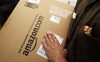 In this Oct. 18, 2010 photo, an Amazon.com package is prepared for shipment in Palo Alto, Calif. THE CANADIAN PRESS/AP, Paul Sakuma