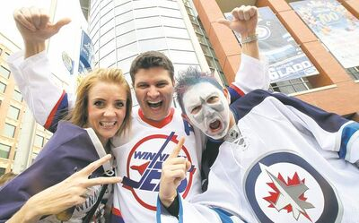 Britt Billson, (from left) Kyle Mackay and Eric Hogue outside the MTS Centre before the Jets' first home game last October. Merchandise sales have surpassed expectations.