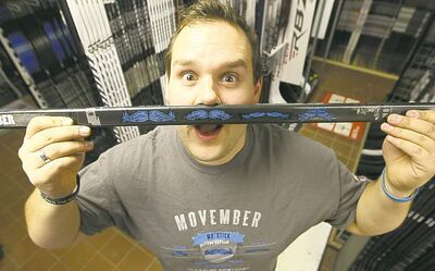 Kyle Johanson, manager of Pembina Highway Source For Sports, with Sher-wood 'Mo' stick.