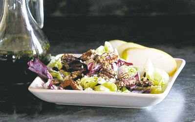 A goat cheese pear salad with maple balsamic created by cookbook authors Betty Reimer and Charlotte Penner.