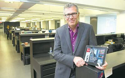 Montreal La Presse publisher Guy Crevier, in the newspaper's new digital  newsroom, shows the French daily's free iPad edition, called La Presse+.