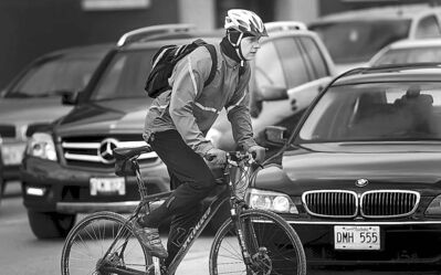 A cyclist manoeuvres through rush-hour traffic on April 24.