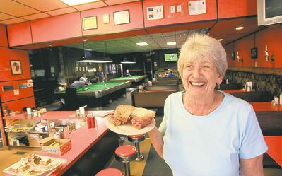 Annette Gougeon, owner of Eddy�s Restaurant and  Billiards on Selkirk Avenue, displays one of her famous corned beef sandwichs.