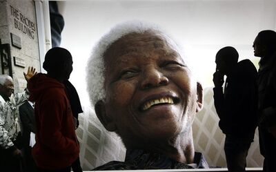 Giant photographs of former president Nelson Mandela are displayed at the Nelson Mandela Legacy Exhibition at the Civic Centre in Cape Town, South Africa, Thursday, June 27, 2013. President Jacob Zuma canceled a trip to Mozambique on Thursday in an indication of heightened concern about Mandela, whose health deteriorated last weekend. (AP Photo)