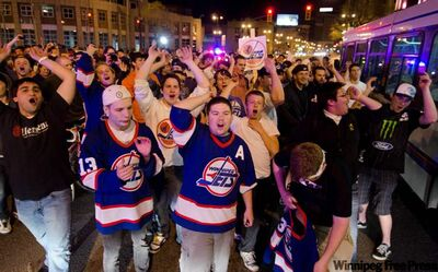 Hundreds of hockey fans converged on Portage and Main May 19 after the Globe and Mail reported the Atlanta Thrashers will be moving to Winnipeg.