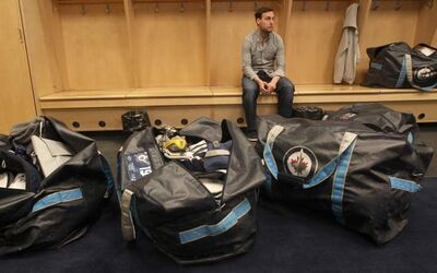 The eloquent and intelligent Kyle Wellwood sits in his locker at the MTS Centre last Sunday, ready to respond to media queries.