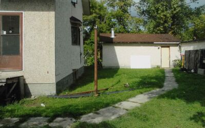 "The rear yard of 703 Prince Rupert Ave. And the entrance to the house and ""mandoor"" of the garage RCMP and the Crown allege Davis was killed in."