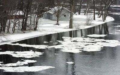 Frazil ice, such as that seen forming on this river in Ontario, is a result of slush and ice crystals that do not totally freeze but have the potential to cause a jam and sudden river rises.